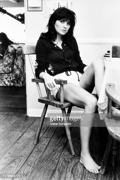 Portrait of American Pop and Country singer Linda Ronstadt as she sits in a chair, Los Angeles, California, 1977.