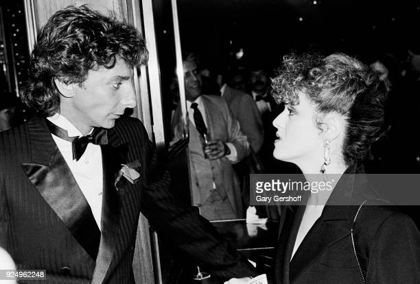 Portrait of American Pop and Jazz musician Barry Manilow talks with actress and musician Bernadette Peters during an after party at the Rainbow Grill...