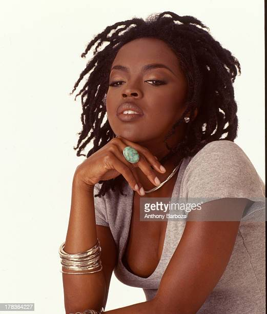 Portrait of American pop and rhythm blues musician Lauryn Hill as she poses with one hand on her chin against a white background New York New York...