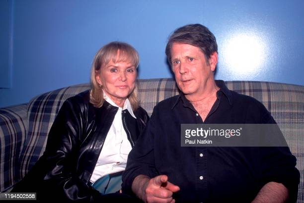 Portrait of American Pop and Rock musicians Jackie DeShannon and Brian Wilson sit together backstage at the Roxy Theater Los Angeles California April...