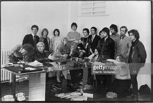Portrait of American pop artist Andy Warhol and others assembled for a photo shoot with Cecil Beaton at Warhol's studio the Factory New York New York...
