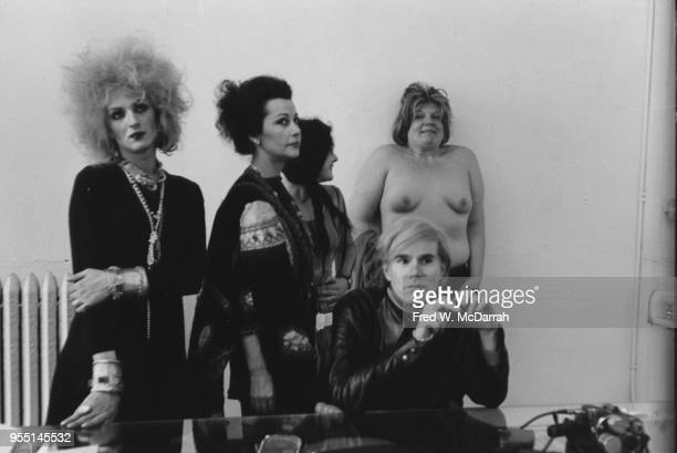 Portrait of American pop artist Andy Warhol and standing from left Candy Darling Ultra Violet unidentified and Brigid Polk at Warhol's studio the...
