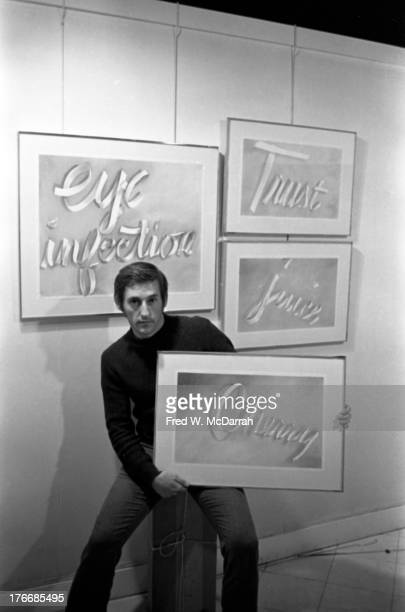 Portrait of American Pop artist Edward Ruscha as he poses with several of his 'Gunpowder Ribbon Drawings,' New York, New York, December 9, 1967.