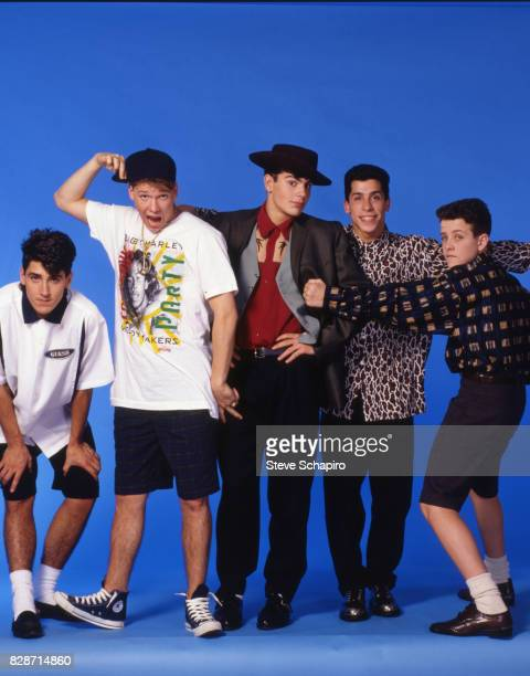 Portrait of American pop group New Kids on the Block posed against a blue background Los Angeles California 1989 Pictured are from left Joey McIntyre...