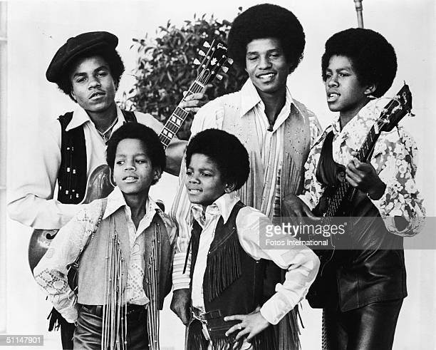 Portrait of American pop group the Jackson 5 standing outdoors, early 1970s. From left, back row Tito Jackson, Jackie Jackson, and Jermaine Jackson;...