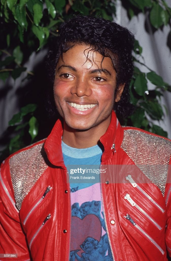 Portrait of American pop star Michael Jackson wearing a red leather jacket at the opening of the stage musical, 'Dream Girls,' Los Angeles, California.
