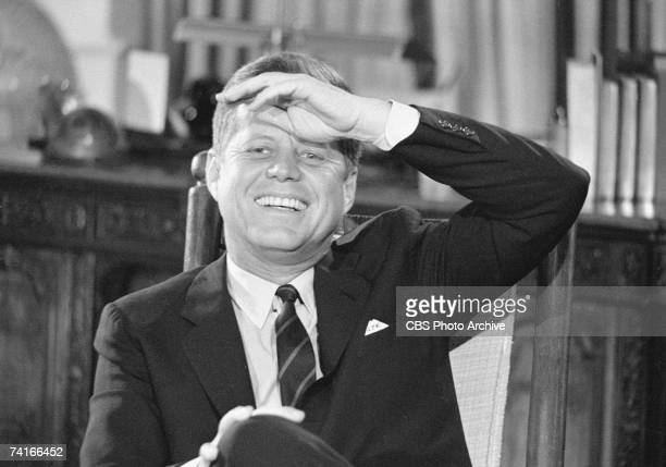 Portrait of American President John F Kennedy in the White House as he laughs during the filming a televised interview entitled 'After Two Years A...