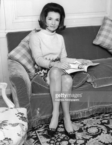 Portrait of American Princess Lee Radziwill sister of Jaqueline Kennedy sitting on a couch 1960s