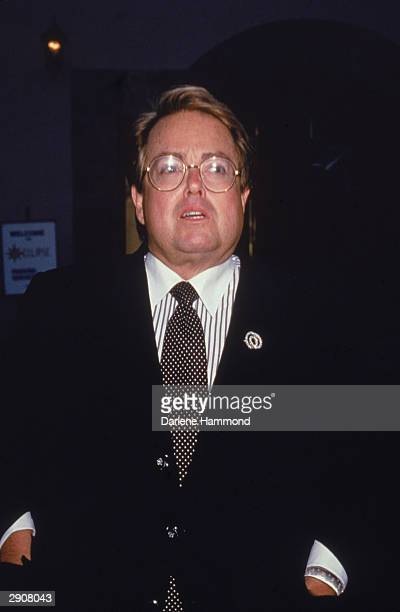 Portrait of American producer Allan Carr wearing a suit and tie, circa 1990s. Carr produced the film 'Grease' in 1978.