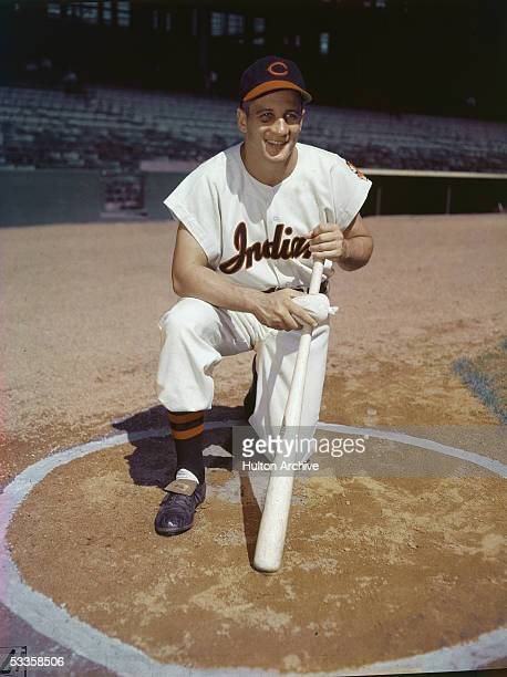 Portrait of American professional baseball player Al Rosen third baseman for the Cleveland Indians kneeling in the batter's circle with a bat 1950s