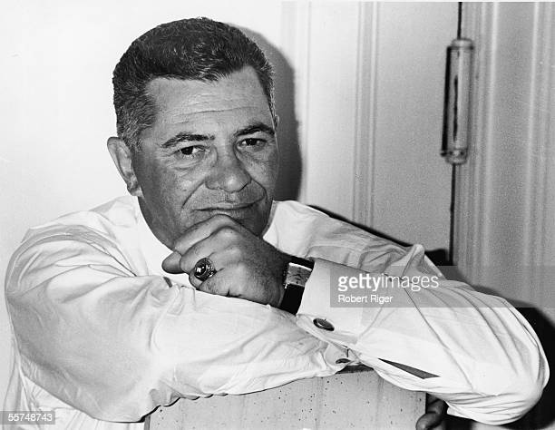 Portrait of American professional football coach Vince Lombardi leans with his arms crossed and wears a Green Bay Packers ring early 1960s Lombardi...