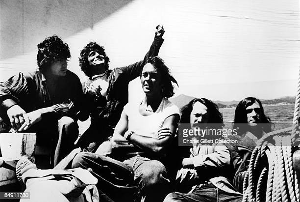 Portrait of American Psychedelic Rock group Quicksilver Messenger Service on the deck of a sailboat, circa 1970. Pictured are, from left, Dino...