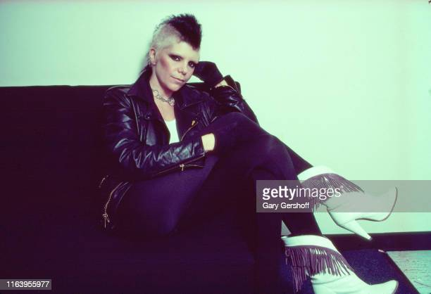 Portrait of American Punk And Heavy Metal singer Wendy O Williams of the group Plasmatics as she sits on a couch backstage at Bond's Casino New York...