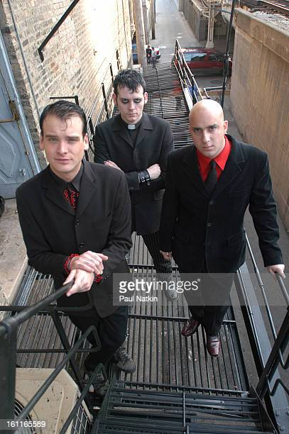 Portrait of American punk band Alkaline Trio as they pose on a fire escape Chicago Illinois October 29 2003 Pictured are from left guitarist Matt...