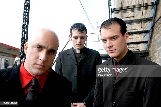 Portrait of American punk band Alkaline Trio as they pose on a fire escape Chicago Illinois October 29 2003 Pictured are from left bassist Dan...