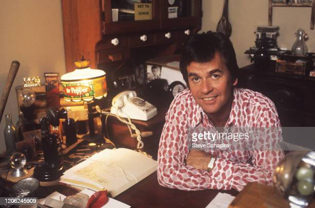 Portrait of American radio and television presenter Dick Clark as he sits in his home office Los Angeles California 1970s