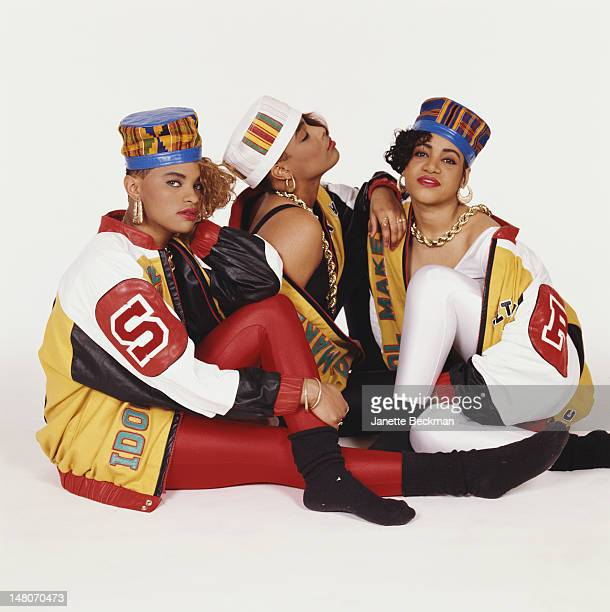 Portrait of American rap trio Salt 'n' Pepa as they pose against a white background New York New York 1988 From left Sandra Denton Deidra Roper and...