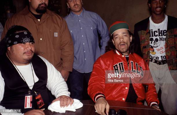 Portrait of American rapper Ice-T poses with unidentified others at the MK Club, New York, New York, April 1990.