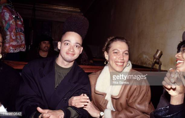 Portrait of American rapper Kid as he poses with an unidentified woman at the MK Club, New York, New York, 1990s.