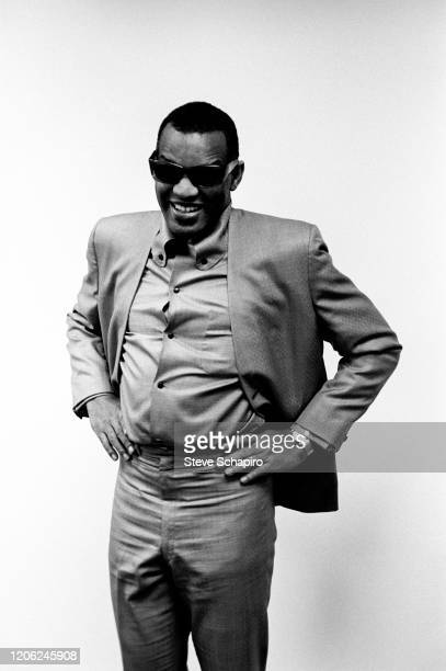 Portrait of American R&B, Pop, and Country musician Ray Charles as he smiles, hands on his hips, during a meeting with his record company, New York,...