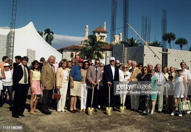 Portrait of American real estate developer Donald Trump and unidentified others during the groundbreaking ceremony for the construction of the...