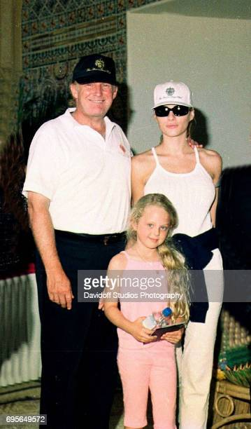 Portrait of American real estate developer Donald Trump his girlfriend former model Melania Knauss and daughter Tiffany as they pose together at the...