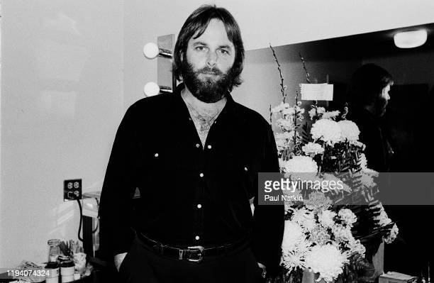 Portrait of American Rock and Pop musician Carl Wilson as he poses in a dressing room, backstage at the Park West, Chicago, Illinois, April 5, 1981.