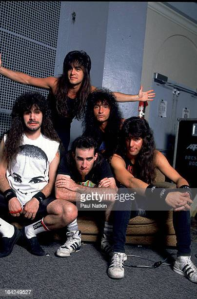 Portrait of American rock band Anthrax as they pose backstage Chicago Illinois December 5 1987 Pictured are from left Charlie Benante Dan Spitz Scott...