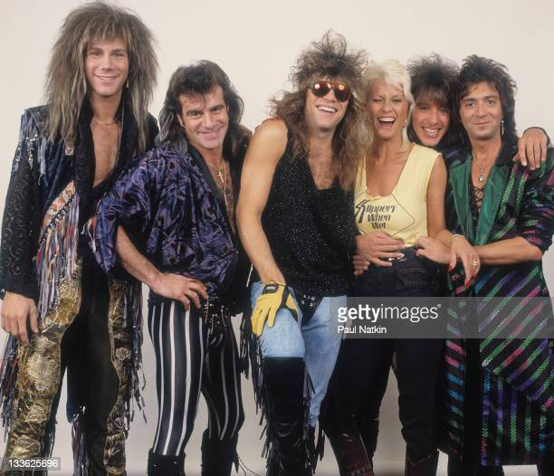 Portrait of American rock band Bon Jovi as they pose with pornographic actress Seka backstage before a performance Illinois early March 1987 Pictured...