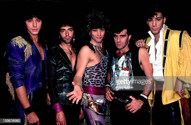 Portrait of American rock band Bon Jovi backstage before a performance at Summerfest Milwaukee Wisconsin June 29 1985 Pictured are from leftAlec John...
