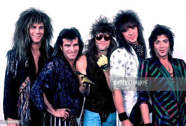 Portrait of American rock band Bon Jovi backstage before a performance Illinois early March 1987 Pictured are from left David Bryan Tico Torres Jon...