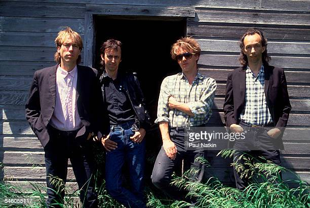 Portrait of American rock group Fire Town as they lean against a wooden building Madison Wisconsin June 2 1987 Pictured are from left Doug Erikson...