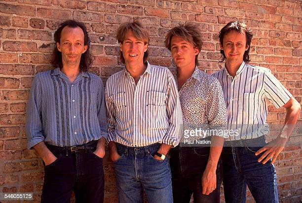 Portrait of American rock group Fire Town as they pose against a brick wall Madison Wisconsin June 2 1987 Pictured are from left Phil Davis Doug...