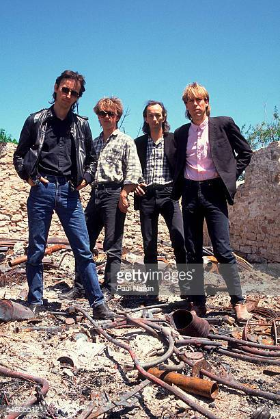 Portrait of American rock group Fire Town as they pose in a junk yard Madison Wisconsin June 2 1987 Pictured are from left Tom LaVarda Butch Vig Phil...
