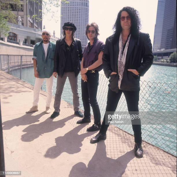 Portrait of American Rock group Izzy Stradlin and the Ju Ju Hounds on the bank of the Chicago River, Chicago, Illinois, May 10, 1992. Pictured are,...