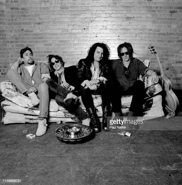 Portrait of American Rock group Izzy Stradlin and the Ju Ju Hounds, seated on a couch, at an unspecified rehearsal space, Chicago, Illinois, May 15,...