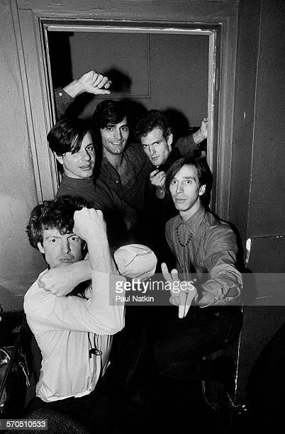 Portrait of American Rock group the Fleshtones as they pose in a doorway backstage at Tuts Chicago Illinois September 23 1983 Pictured are from left...