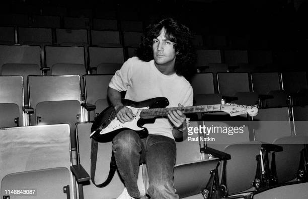 Portrait of American Rock musician Billy Squier as he poses guitar in his arms at the Rosemont Horizon Rosemont Illinois November 7 1981