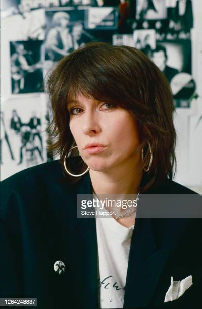Portrait of American Rock musician Chrissie Hynde, of the group the Pretenders, at her management office in Kentish Town, London, circa 1986.
