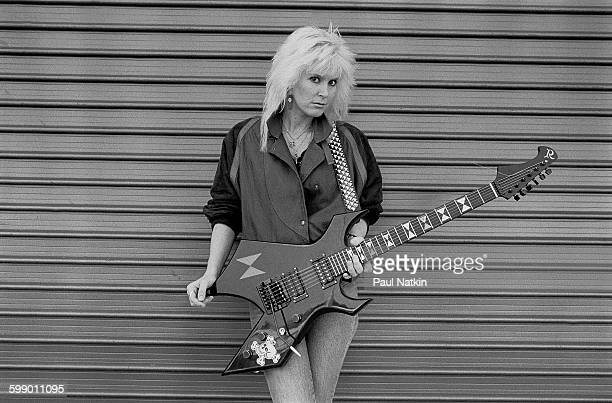 Portrait of American Rock musician Lita Ford as she poses outdoors with guitar Los Angeles California March 18 1985