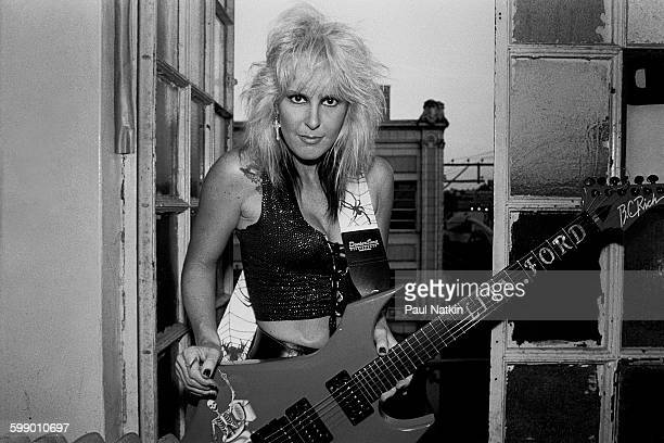 Portrait of American Rock musician Lita Ford as she poses with a guitar at the Aragon Ballroom Chicago Illinois June 11 1988