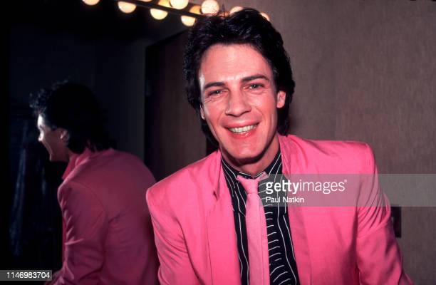 Portrait of American Rock musician Rick Springfield as he poses backstage at the Mill Run Theater, Niles, Illinois, September 6, 1981.
