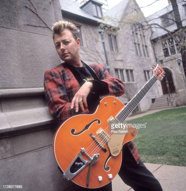 Portrait of American Rockabilly and Rock musician Brian Setzer as he poses with his guitar Chicago Illinois April 15 1996