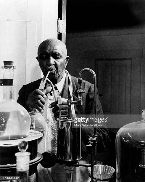 Portrait of American scientist and botanist George Washington Carver at work in a laboratory 1940s