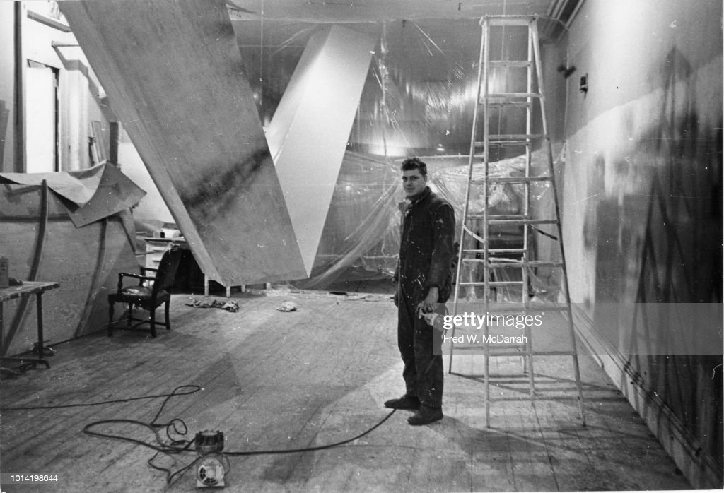 Portrait of American sculptor Robert Grosvenor as he poses with his work in his downtown studio, New York, New York, November 12, 1965.