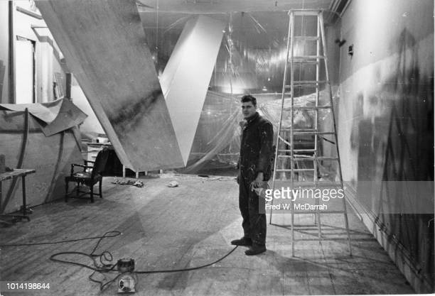 Portrait of American sculptor Robert Grosvenor as he poses with his work in his downtown studio New York New York November 12 1965