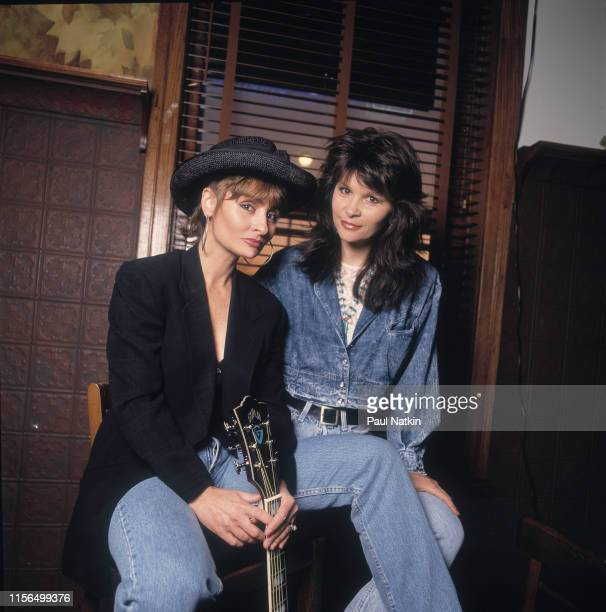 Portrait of American sibling Country musicians Janis Gill and Kristine Arnold together the duo Sweethearts of the Rodeo as they pose backstage at...