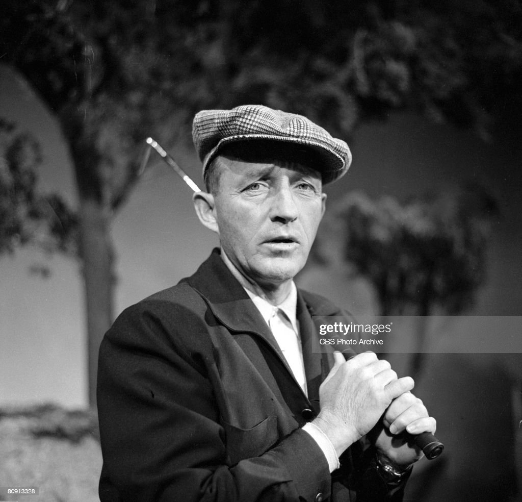 Portrait of American singer and actor Bing Crosby (1903 - 1977), a golf club over his shoulder, on the set of his television variety special 'Bing Crosby and His Friends,' December 18, 1957. It was originally broadcast on January 12, 1958.