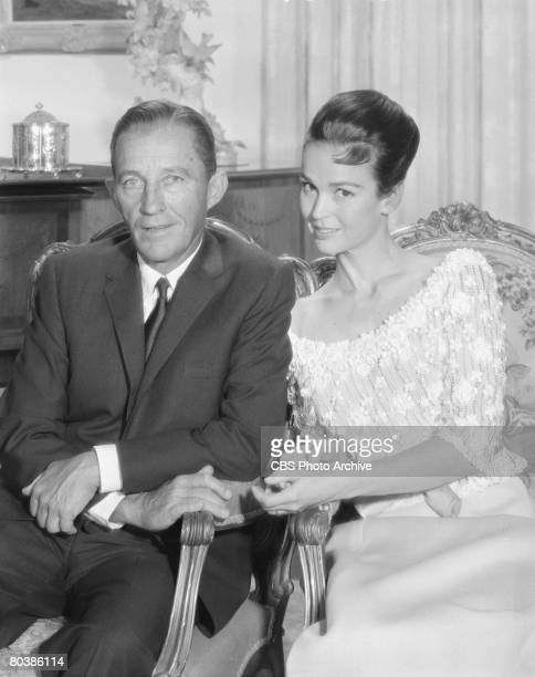 Portrait of American singer and actor Bing Crosby and his wife actress Kathryn Crosby as they sit together December 6 1963