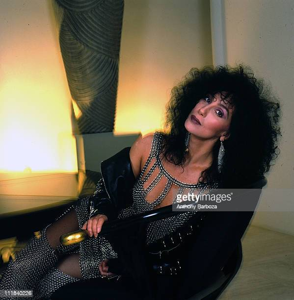 Portrait of American singer and actress Cher as she relaxes in Los Angeles California 1987